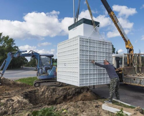 спуск септика на грузовом кране